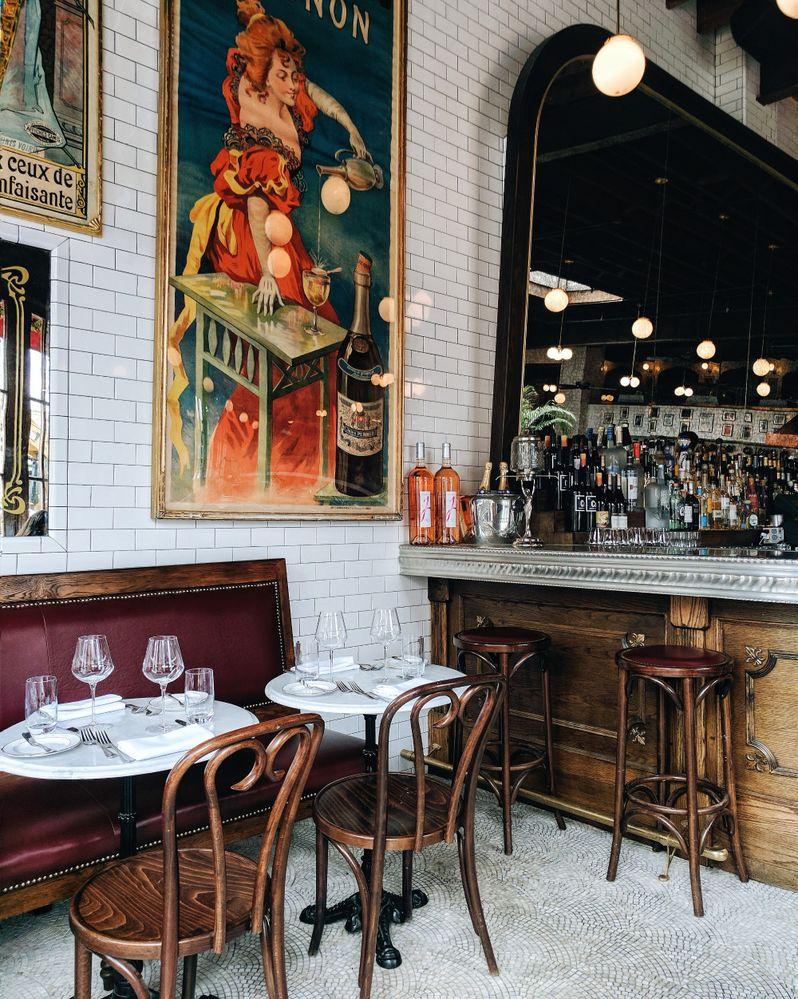 Caption: Empty tables inside Boucherie, a Parisian-styled restaurant in New York.