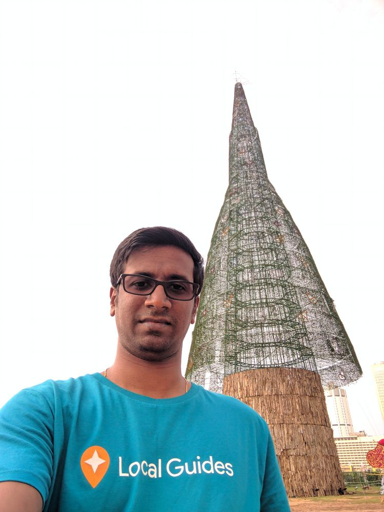 Ilankovan with world's tallest artificial Christmas tree