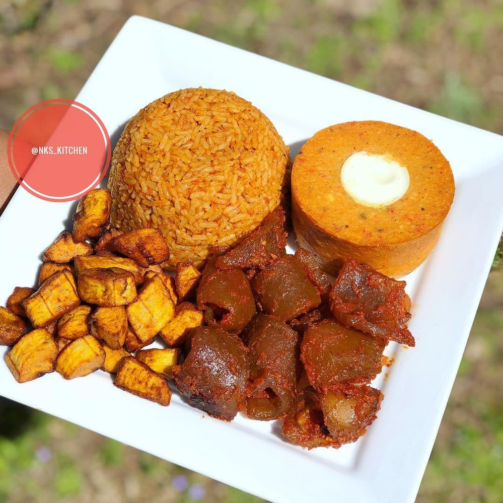 Nigerian moinmoin with Jollof rice