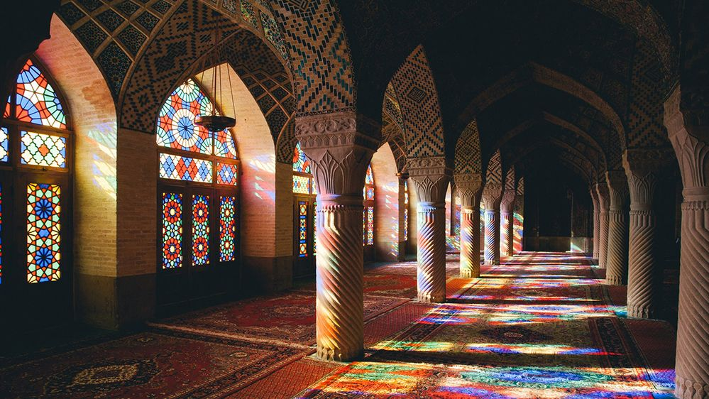 A photo of the stained glass windows and interior of Nasirolmolk Mosque in Shiraz, Iran. (Local Guide O.I.B. de Rijcke)